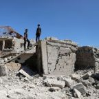 Syria pounds rebel areas in south, thousands flee to border zone