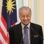 Malaysia's Mahathir quits at 94 but agrees to stay as interim PM