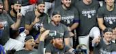 Justin Turner (bottom, middle) celebrates with teammates after winning the World Series. (Getty Images)