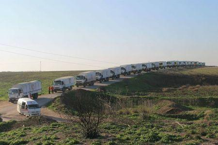 Aid trucks line a road before their departure for Damascus in this handout photo released February 17, 2016. REUTERS/Syrian Arab Red Crescent/Handout via Reuters