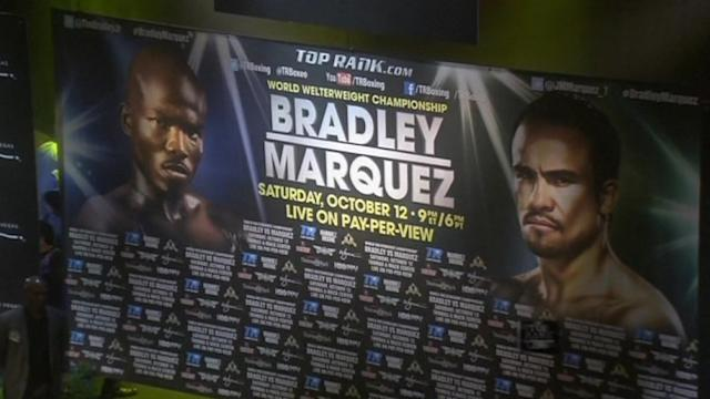 Bradley and Marquez weigh in ahead of their fight
