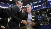 US stock indexes step back after a big gain; retailers climb