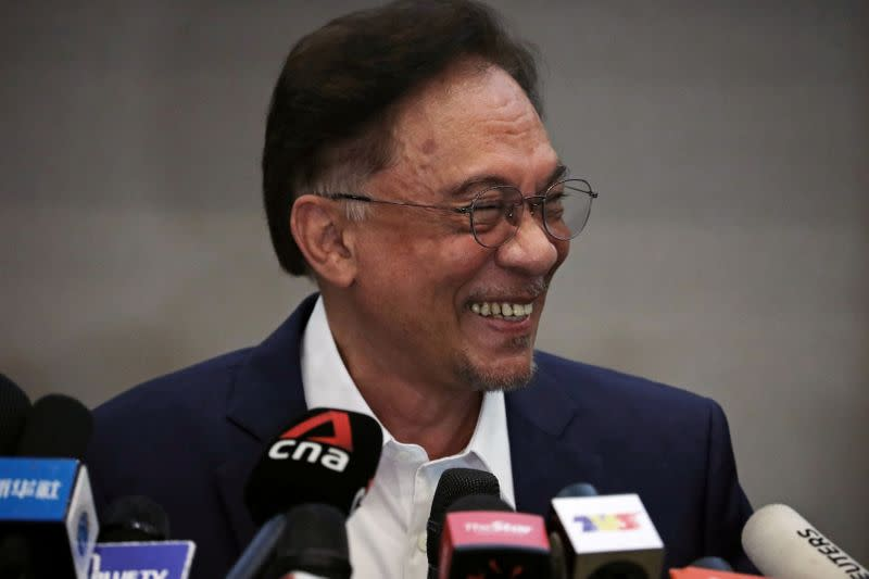 Malaysia opposition leader Anwar Ibrahim reacts during a news conference in Kuala Lumpur