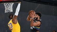 Watch Jamal Murray hit insane hand-switching layup around LeBron