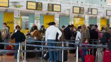 Why was our Vueling flight booking cancelled at check-in?