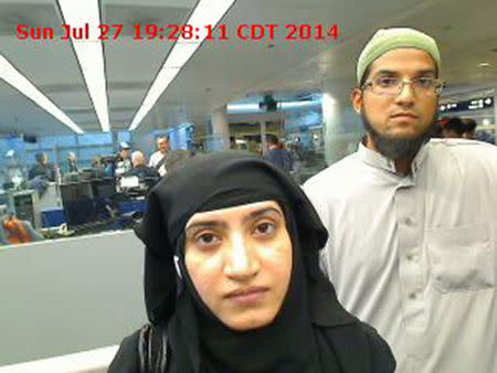 Tashfeen Malik, (L), and Syed Farook are pictured passing through Chicago's O'Hare International Airport in this July 27, 2014 handout photo obtained by Reuters December 8, 2015. REUTERS/US Customs and Border Protection/Handout via Reuters