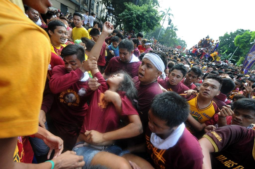 Hundreds were injured during the religious gathering as shoeless devotees hurled themselves at a statue of Jesus believed to have healing powers (AFP Photo/Jay Directo)
