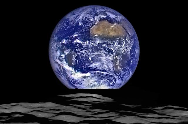 Lunar Orbiter captures the Earth rising from the moon's horizon