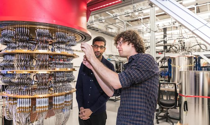A handout picture from October 2019 shows Sundar Pichai and Daniel Sank (R) with one of Google's Quantum Computers in the Santa Barbara lab, California, U.S. Picture taken in October 2019.      Google/Handout via REUTERS        THIS IMAGE HAS BEEN SUPPLIED BY A THIRD PARTY.