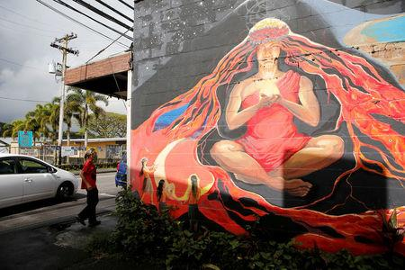 FILE PHOTO: A mural of the Hawaiian goddess Pele is depicted on a wall of a local art gallery in Pahoa, Hawaii, U.S., May 25, 2018. REUTERS/Marco Garcia/File Photo