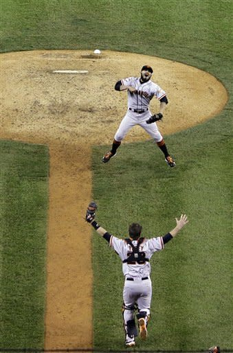 San Francisco Giants relief pitcher Sergio Romo (54) and catcher Buster Posey and celebrate after striking out Detroit Tigers third baseman Miguel Cabrera (24) to win Game 4 of baseball's World Series Sunday, Oct. 28, 2012, in Detroit. The Giants won 4-3. (AP Photo/Tim Donnelly)