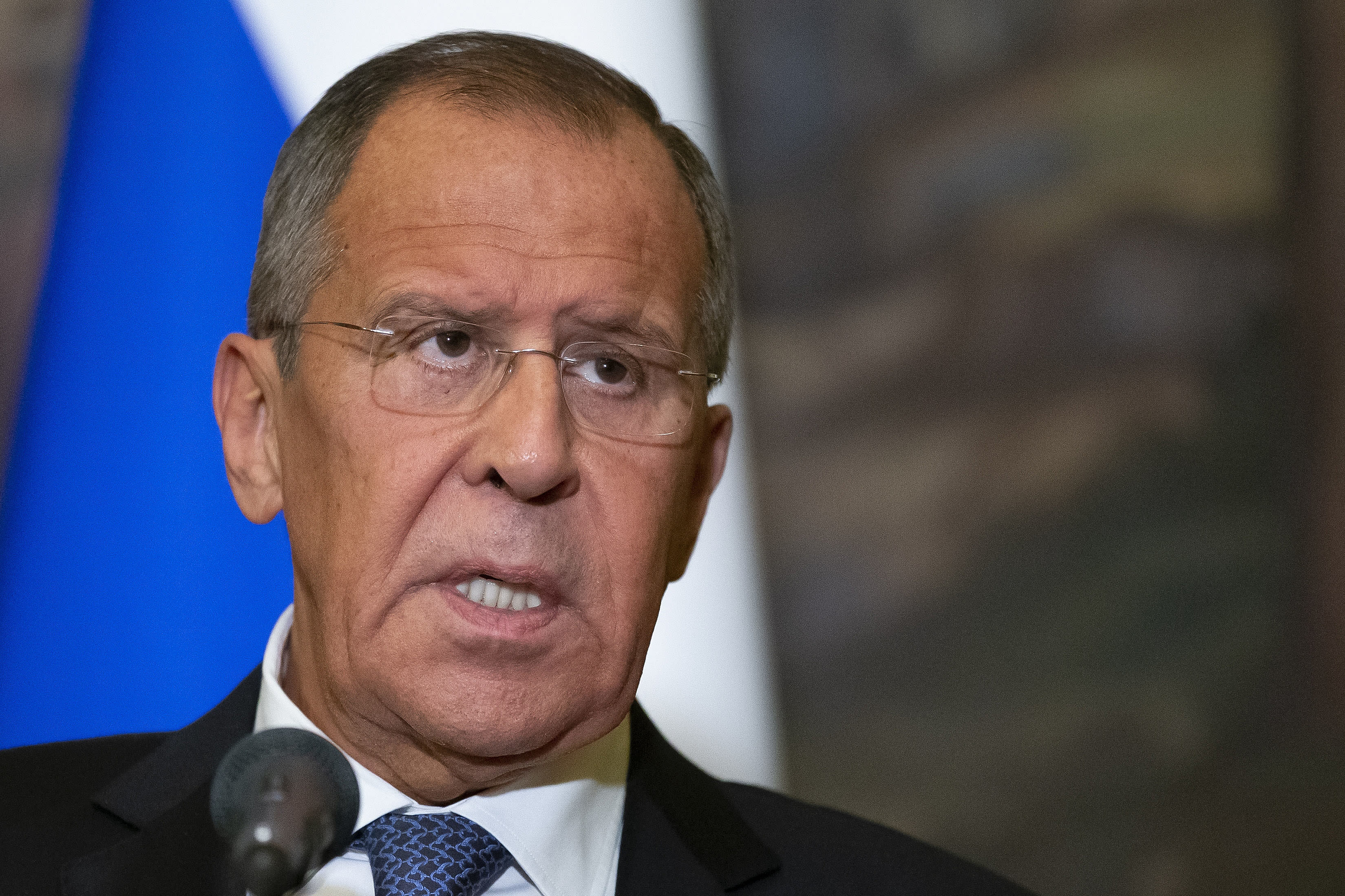 Russian Foreign Minister Sergey Lavrov speaks to the media during a joint news conference with Syrian Foreign Minister Walid Muallem following their talks in Moscow, Russia, Thursday, Aug. 30, 2018. Muallem's Moscow visit comes as Moscow and Damascus are increasingly worried about a possible airstrike on government positions in Syria. (AP Photo/Alexander Zemlianichenko)