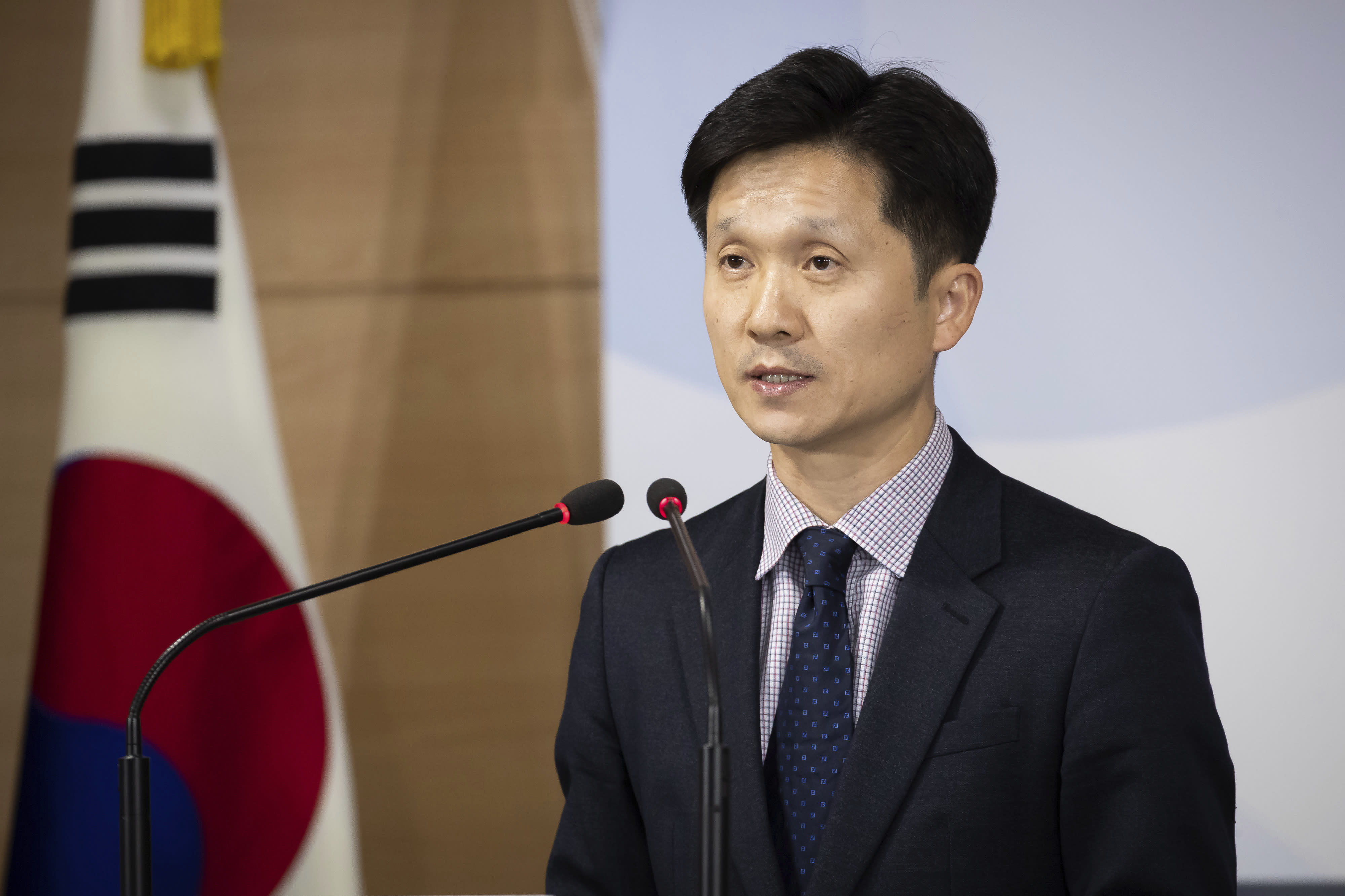 South Korean Unification Ministry spokesman Lee Sang-min briefs the media at a government complex in downtown Seoul, South Korea, Thursday, Nov. 7, 2019. South Korea says it has deported 2 North Koreans after finding they had killed 16 fellow fishermen onboard and fled to South Korea. (Kim Seung-doo/Yonhap via AP)