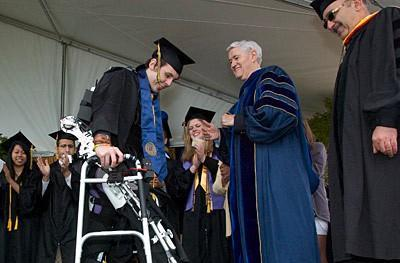 Paralyzed student uses robotic exoskeleton to walk at college graduation (video)