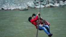 Just zipping out to the shops - mountain dwellers soar over angry rapids in China