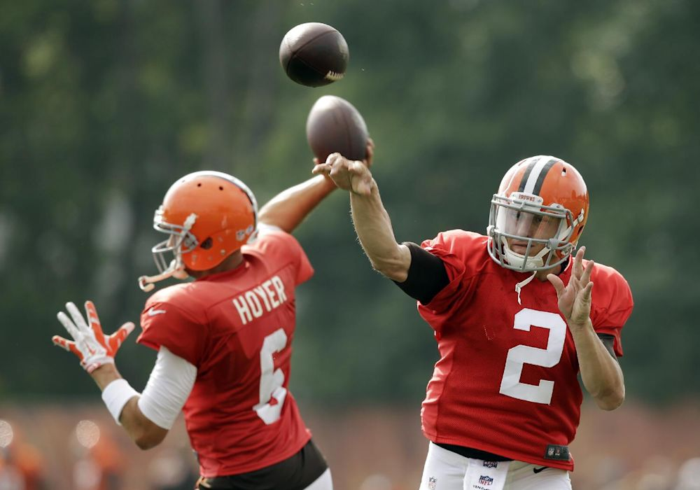 Cleveland Browns quarterbacks Johnny Manziel (2) and Brian Hoyer pass during practice at NFL football training camp in Berea, Ohio Tuesday, Aug. 12, 2014