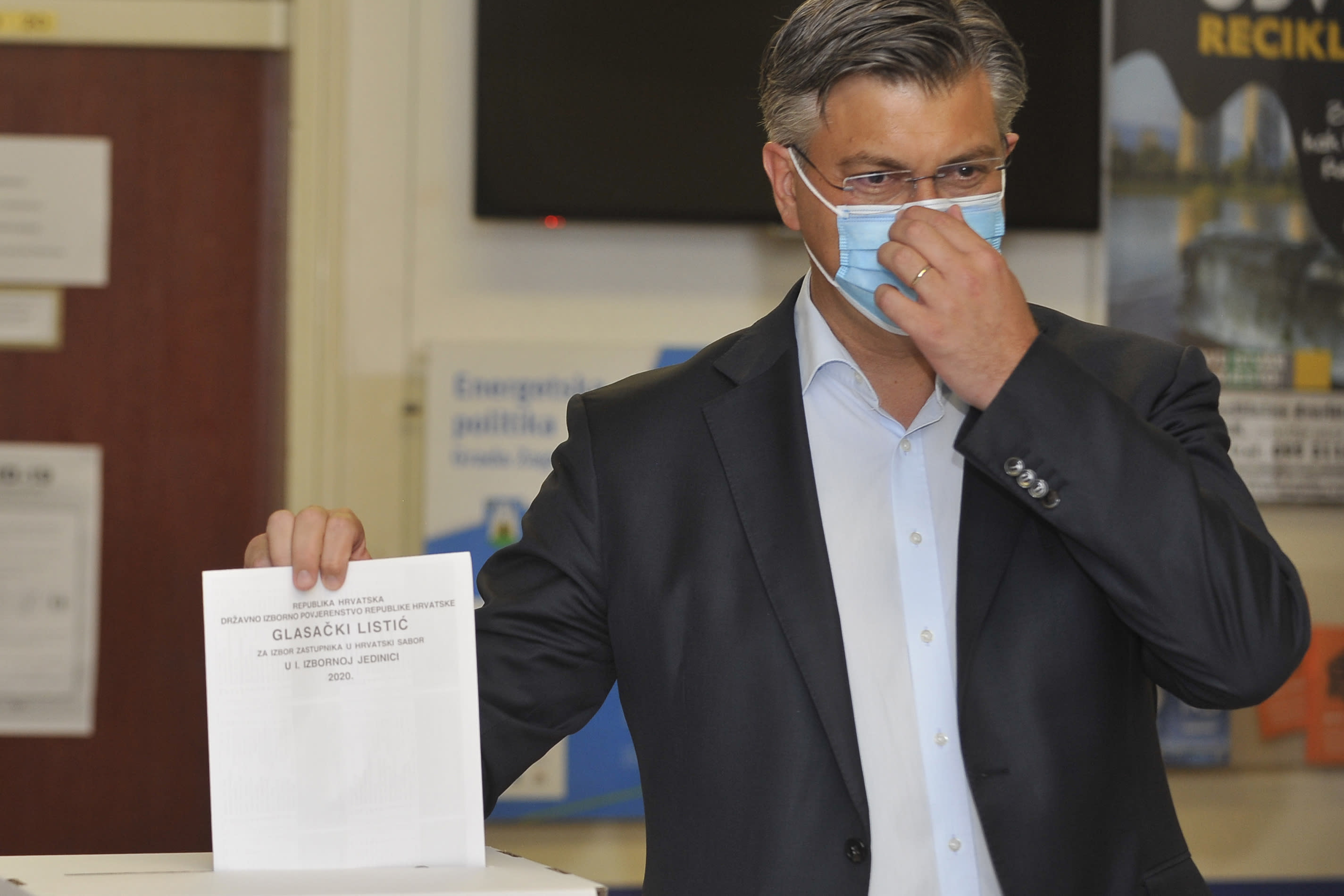 Andrej Plenkovic, Croatia's Prime Minister incumbent casts his ballot at a polling station in Zagreb, Croatia, Sunday, July 5, 2020. Amid a spike of new coronavirus cases, voters in Croatia cast ballots on Sunday in what is expected be a close parliamentary race that could push the latest European Union member state further to the right. (AP Photo)