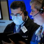 Dow sinks, virus pushes it to sharpest quarterly plunge in over three decades