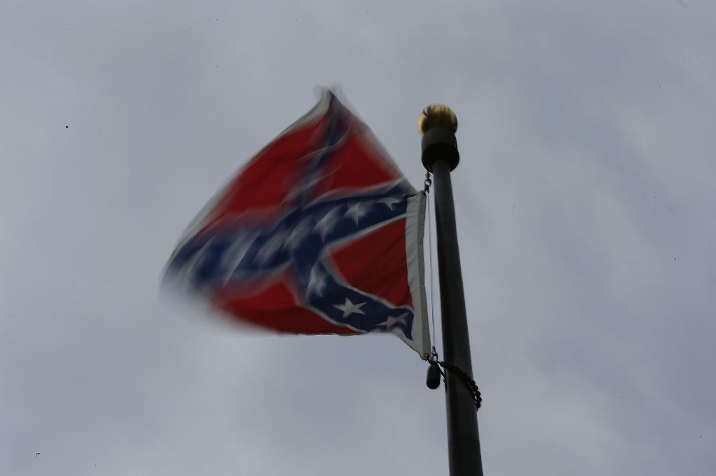The decision to ban images of the Confederate flag from Virginia state license plates by Governor Terry McAuliffe comes a day after South Carolina's Governor Nikki Haley called for the removal of the flag from the grounds of her state's legislature