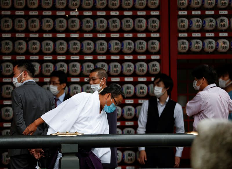 Visitors wearing protective face masks are seen at a shrine amid the coronavirus disease (COVID-19) outbreak, in Tokyo