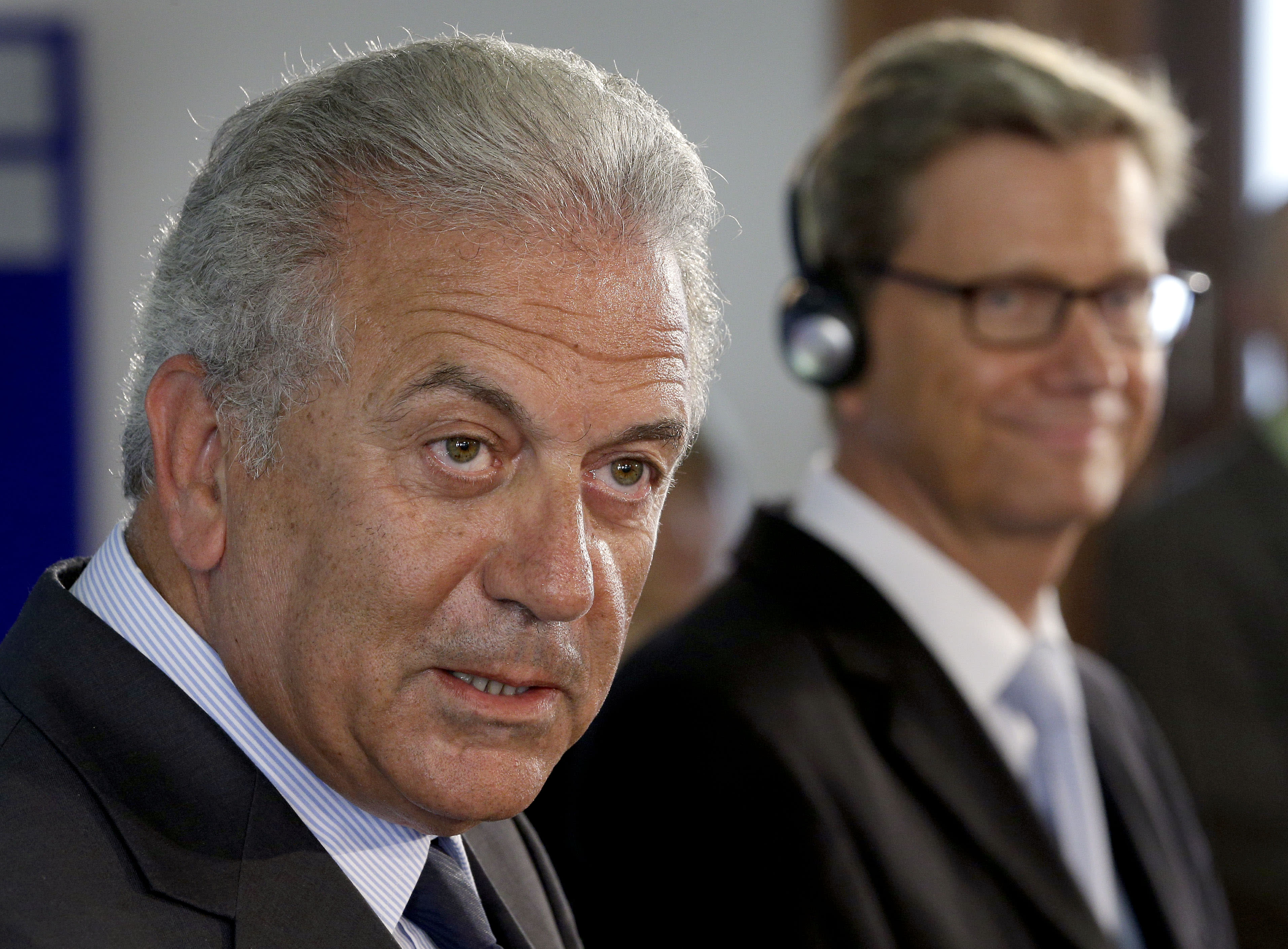 German Foreign Minister Guido Westerwelle right, and his counterpart from Greece, Dimitris Avramopoulos, left, address the media during a joint press conference after a meeting at the foreign office in Berlin, Germany, Monday, Aug. 20, 2012. (AP Photo/Michael Sohn)