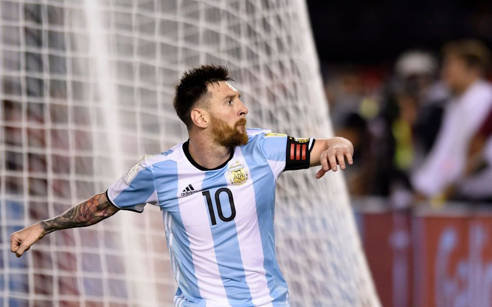 Argentina's Lionel Messi celebrates after scoring a penalty against Chile - AP