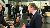 Cameron Pushes Reform Agenda at Riga Summit