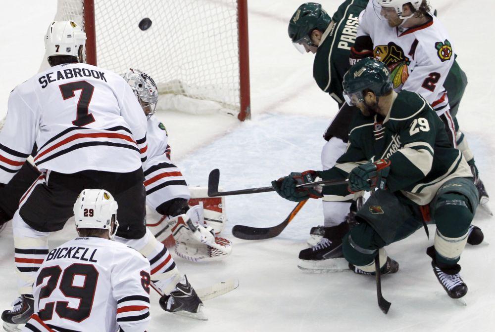 Wild barrage on Crawford beats Blackhawks 4-2