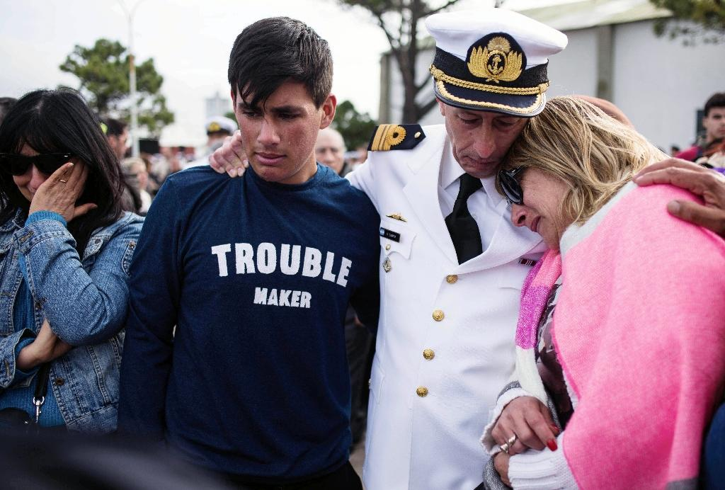 Photo released by Telam of relatives and friends of the crew members of the ARA San Juan submarine, mourning during a ceremony a year after the submarine went missing, at Mar del Plata's naval base, in Buenos Aires province on November 15, 2018 (AFP Photo/Diego IZQUIERDO)