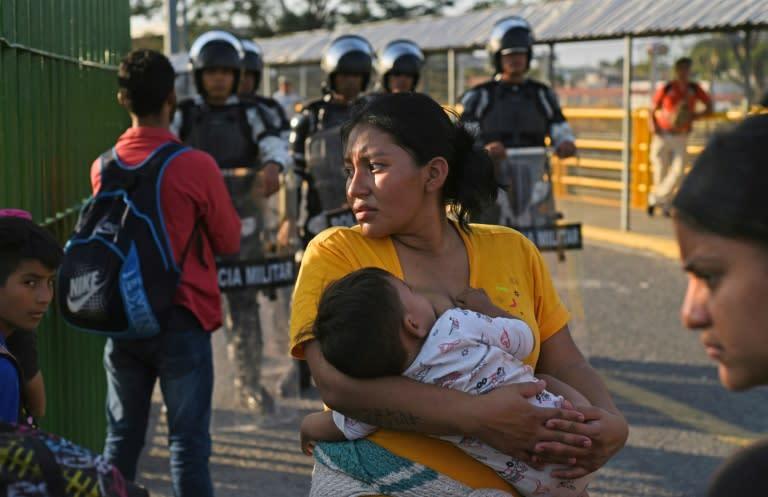 Honduran migrants wait to cross the international border bridge from Ciudad Tecun Uman in Guatemala to Ciudad Hidalgo in Mexico in January 2020