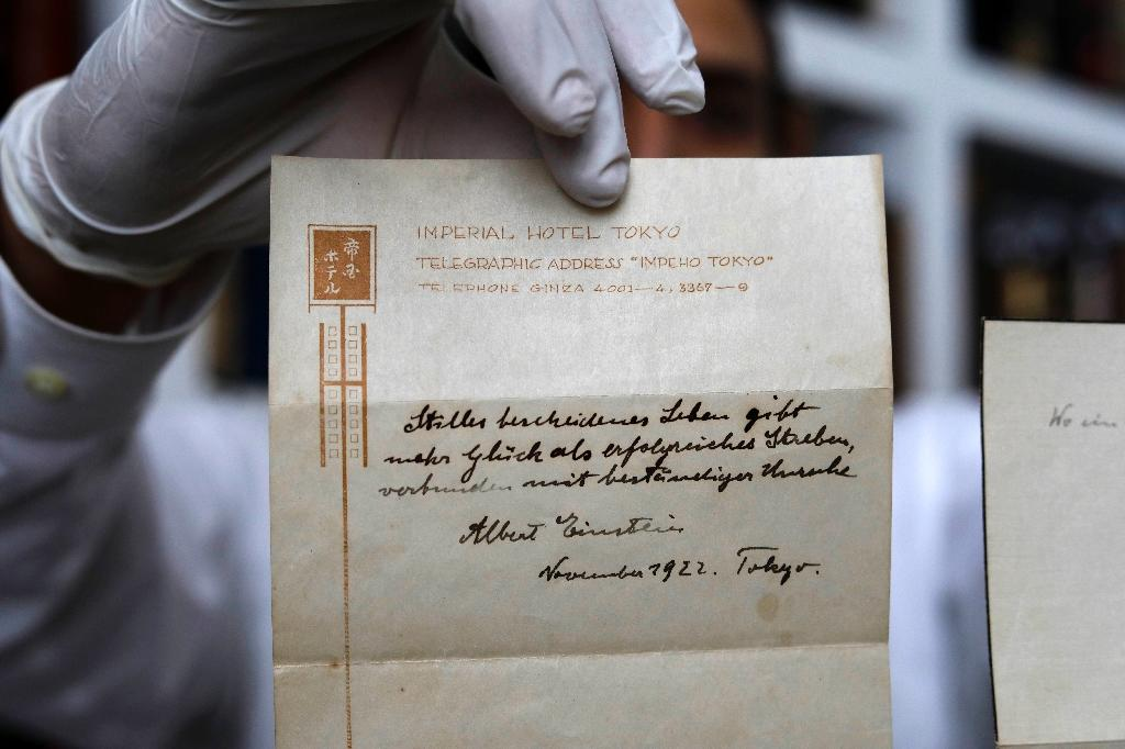 A picture taken on October 19, 2017 shows one of two notes written by Albert Einstein, in 1922, on stationary from the Imperial Hotel in Tokyo