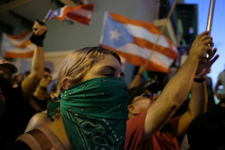 Demonstrators protest in front of the mansion of Puerto Rico's Governor, Ricardo Rossello, before he announced his resignation (AFP Photo/Ricardo ARDUENGO)