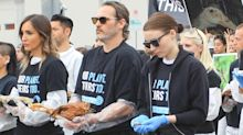 Joaquin Phoenix and Rooney Mara carry dead animals in protest