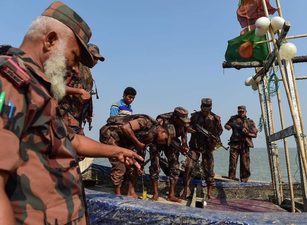 Bangladesh Border Guard personnel search a fishing boat during their patrol along the Naf River marking the border between Myanmar and Bangladesh. Methamphetamine is spilling into Bangladesh at record rates from Myanmar (AFP Photo/MUNIR UZ ZAMAN)