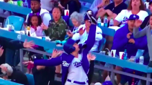 Billie Jean King cheers on Dodgers' ball girl who made amazing catch
