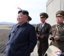 Analysis: Kim, returning to military optics, turns up heat