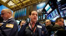 U.S. shares rise, yields drop as rate fears ebb