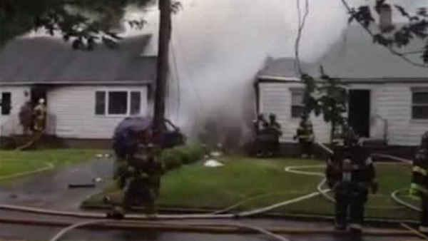 Plane crashes into homes in East Haven