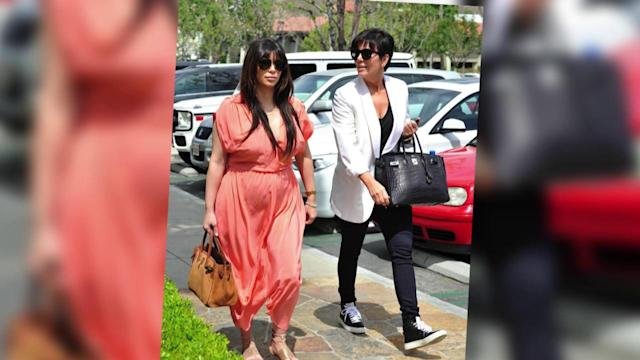 Kim Kardashian's Dress Balloons in the Wind After Flaunting Bare Baby Bump