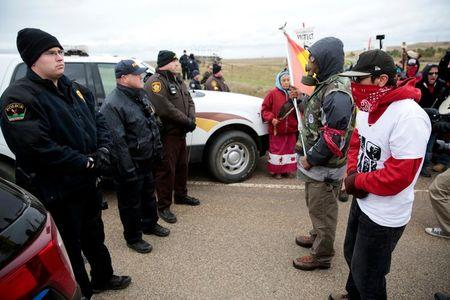 Dakota Access Pipeline protesters square off against police between the Standing Rock Reservation and the pipeline route outside the little town of Saint Anthony, North Dakota, U.S., October 5, 2016. REUTERS/Terray Sylvester/File Photo