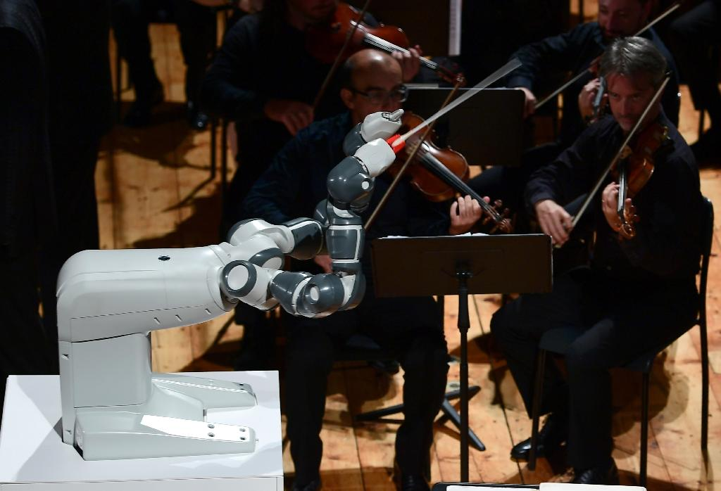 YuMi, designed by Switzerland's ABB, conducts the Lucca Philharmonic Orchestra on Tuesday at the Teatro Verdi in Pisa, Italy (AFP Photo/MIGUEL MEDINA)