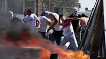 Israel prepares for retaliation, as Palestinians mourn murdered teen
