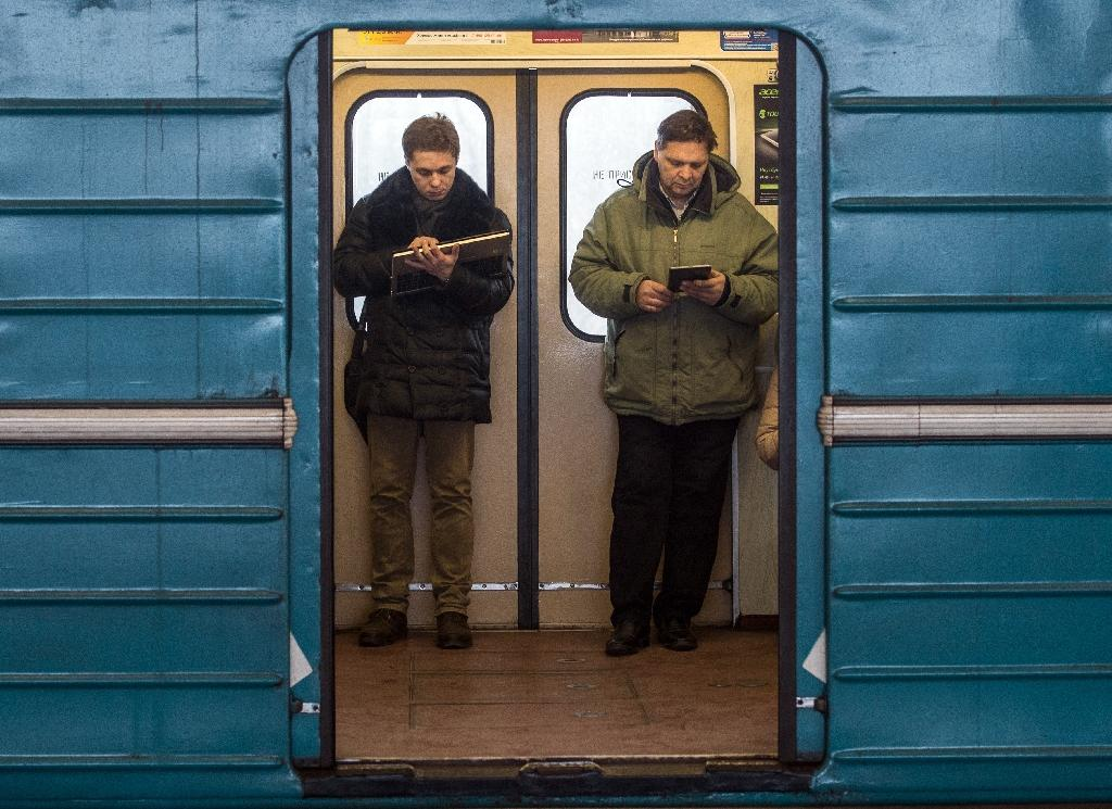 The metro in Moscow has high-speed wireless Internet, allowing commuters to use phones and computers in the trains (AFP Photo/Dmitry Serebryakov)