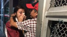 High school graduate reunites with deported dad at U.S.-Mexico border in emotional video
