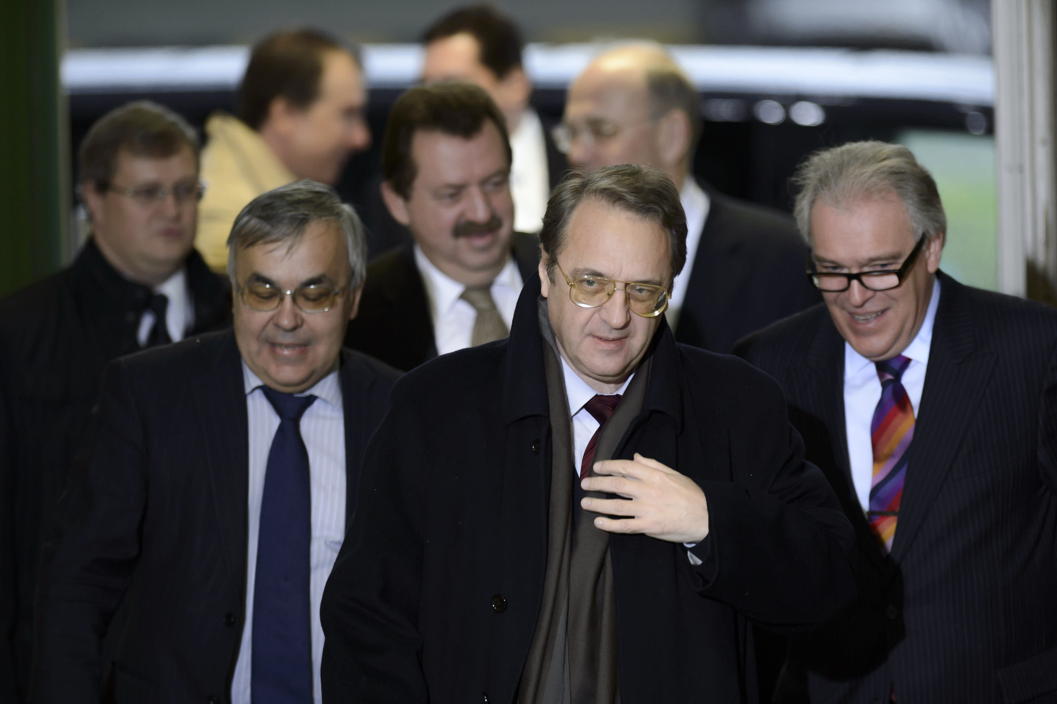 Russian deputy Foreign Ministers Mikhail Bogdanov, center, arrives for a meeting with UN Joint Special Representative for Syria Lakhdar Brahimi and U.S. Under Secretary of State for Political Affairs Wendy Sherman at the European headquarters of the United Nations, in Geneva, Switzerland, Wednesday, Dec. 20, 2013. Brahimi is meeting with U.S. and Russian delegations to try to agree which nations should be invited to Syria peace talks in Geneva next month. (AP Photo/Keystone, Martial Trezzini)