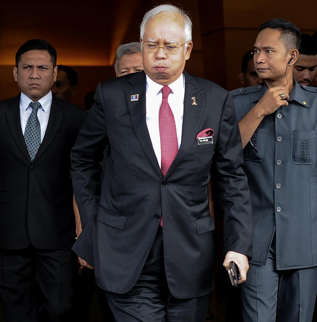 Malaysian Prime Minister Najib Razak has for months fended off accusations that a huge payment made into his personal bank accounts in 2013 was syphoned off from a state-owned company he had launched (AFP Photo/Mohd Rasfan)