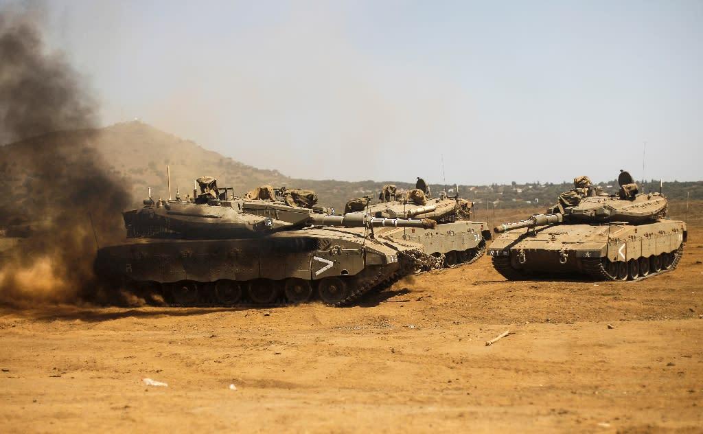 Israeli tanks take part in a military exercise in the Israeli-annexed Golan Heights on September 13, 2017