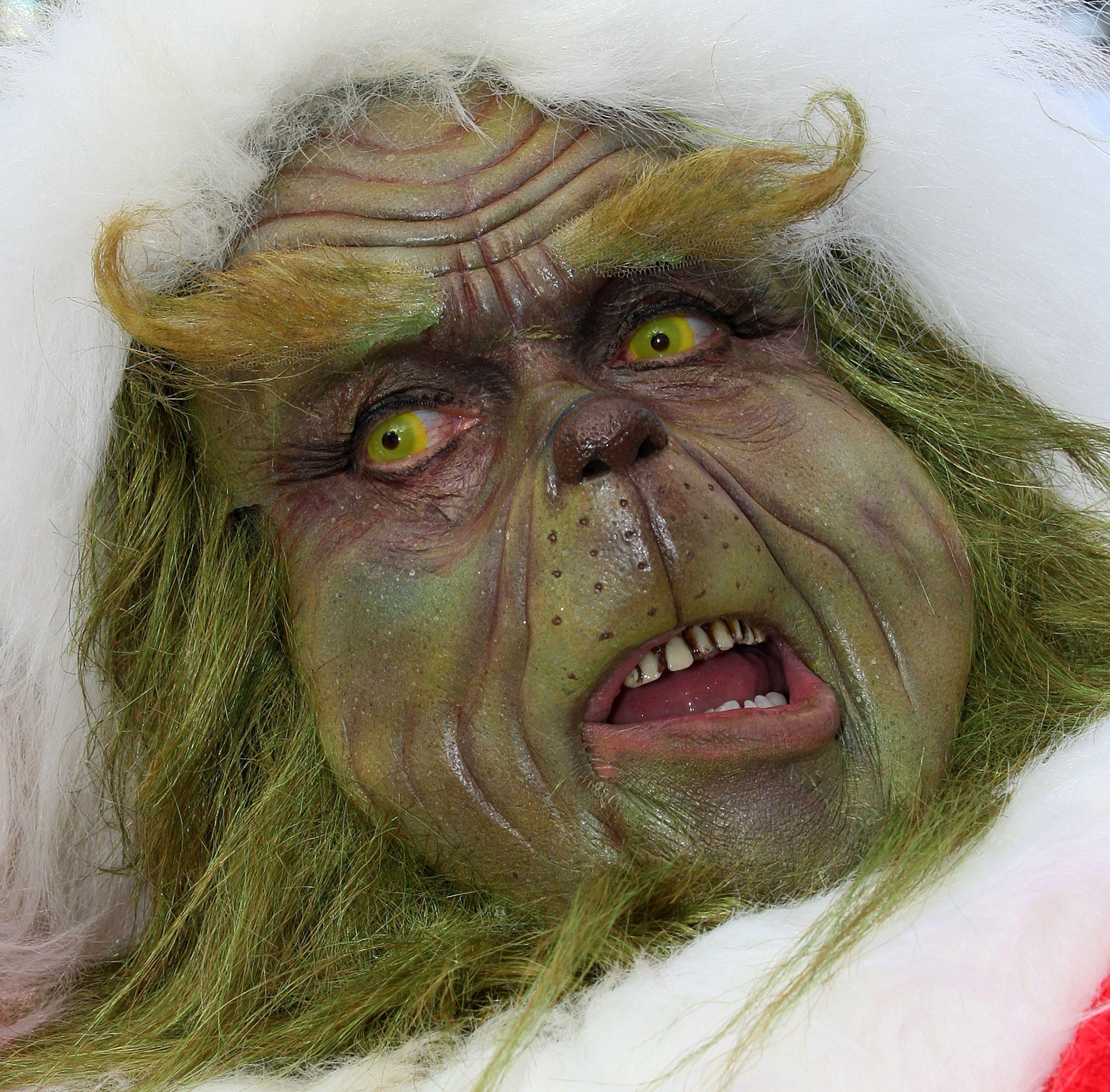 See State Troopers 'Detain' The Grinch During Christmas Toy