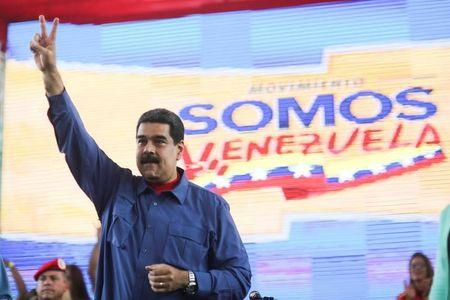Venezuela's President Nicolas Maduro gestures as he arrives for an event with supporters in Caracas, Venezuela July 20, 2017. Miraflores Palace/Handout via REUTERS