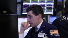 Stocks indexes settle down, but small companies drop again
